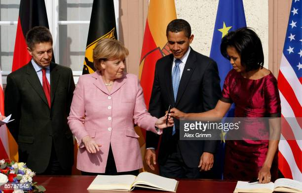 S President Barack Obama his wife Michelle German Chancellor Angela Merkel and her husband Joachim Sauer sign the Golden Book of the city of Baden...