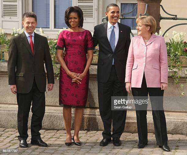 S President Barack Obama his wife Michelle German Chancellor Angela Merkel and her husband Joachim Sauer pose for photographers upon Obama's arrival...