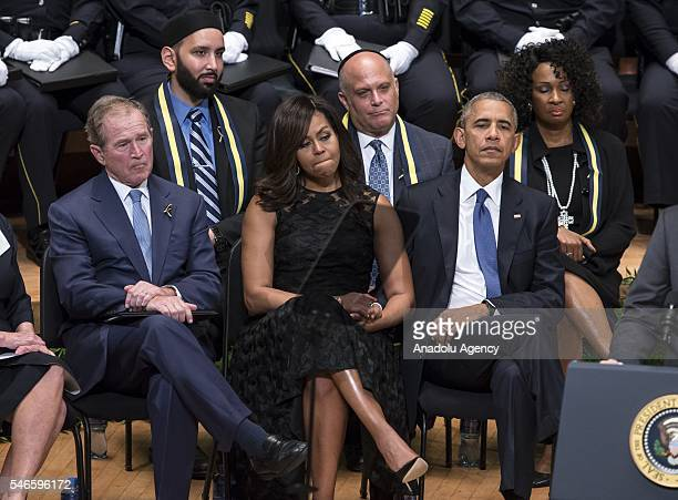 S President Barack Obama his wife Michelle Obama and Former US President George W Bush attend a memorial service for the victims of the Dallas police...