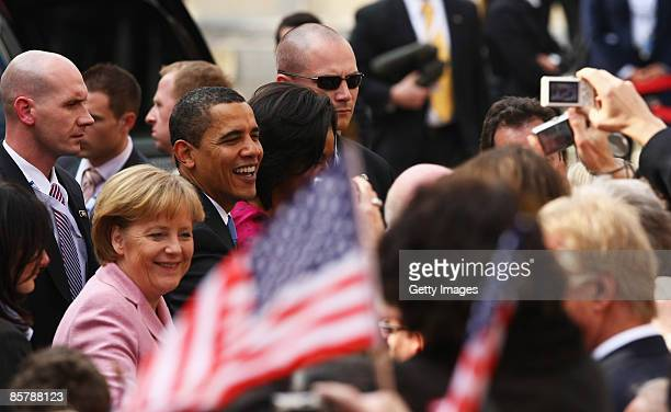 S President Barack Obama his wife Michelle Obama and German Chancellor Angela Merkel walk to city hall upon Obama�s arrival for bilateral talks on...