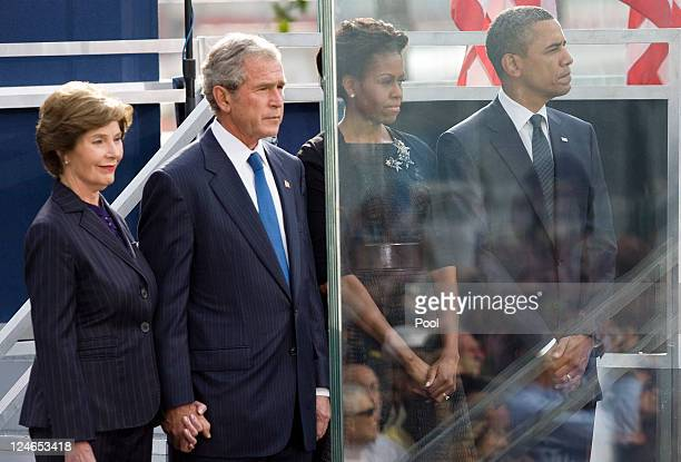 S President Barack Obama his wife Michelle Obama former President George W Bush and his wife Laura Bush observe a moment of silence at the time the...