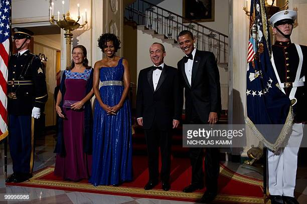 US President Barack Obama his wife Michelle Obama Mexican President Felipe Calderon and his wife Margarita Zavala arrive to pose for pictures at the...