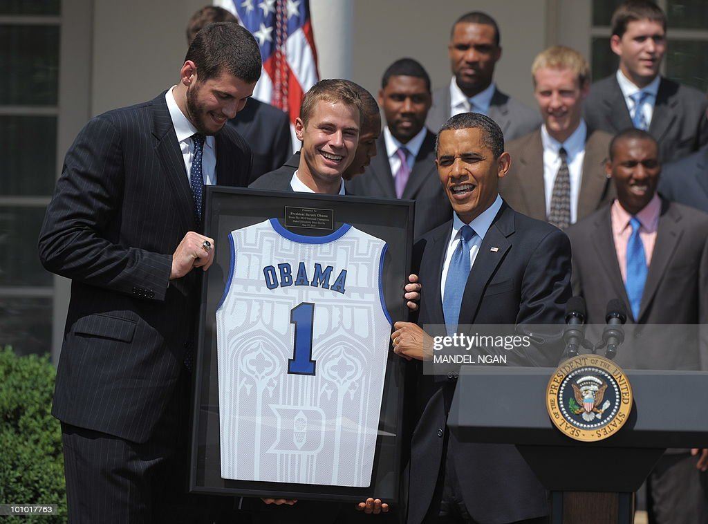 US President Barack Obama hold a jersey presented to him by members of the Duke Blue Devils during an event in honor of the NCAA Men�s Basketball Champions May 27, 2010 in the Rose Garden of the White House in Washington, DC. AFP PHOTO/Mandel NGAN