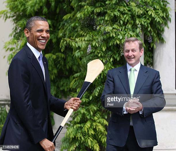 S President Barack Obama holds a hurley after it was given to him by Irish Prime Minister Taoiseach Enda Kenny at Farmleigh May 23 2011 in Dublin...