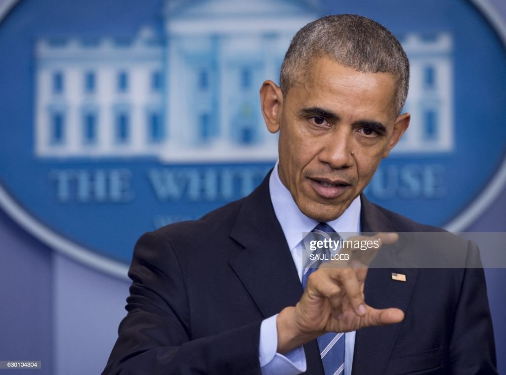 US President Barack Obama holds a year-end press conference in the Brady Press Briefing Room of the White House in Washington, DC, December 16, 2016. Obama said Friday he had confronted Vladimir Putin in person over allegations of Russian hacking when they met ahead of the US election, telling him to 'cut it out.' / AFP / SAUL