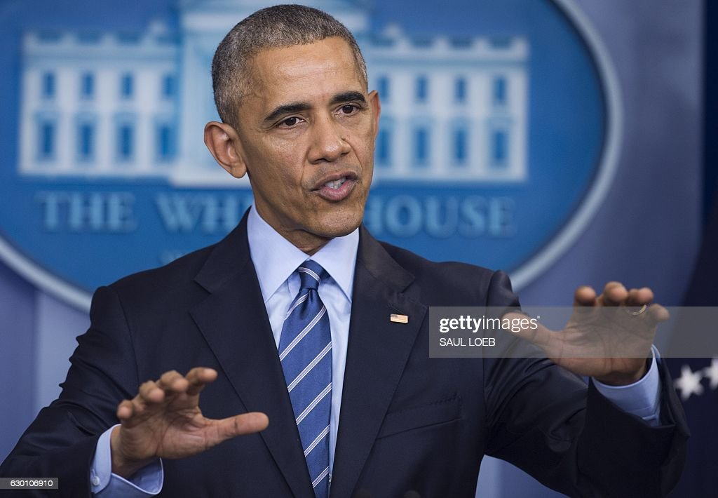 US President Barack Obama holds a year-end press conference in the Brady Press Briefing Room of the White House in Washington, DC, December 16, 2016. Obama on Friday warned his successor Donald Trump against antagonizing China by reaching out to Taiwan, saying he could risk a 'very significant' response if he upends decades of diplomatic tradition. / AFP / SAUL