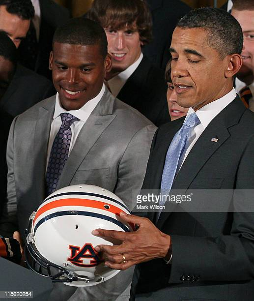 President Barack Obama holds an Auburn Tigers helmet given to him by members of the 2011 BCS National Champion Auburn University football team...