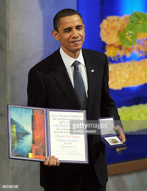 US President Barack Obama holds his Noble Peace Prize during the Nobel Peace Prize Ceremony at the Oslo City Hall in Oslo on December 10 2009 The...
