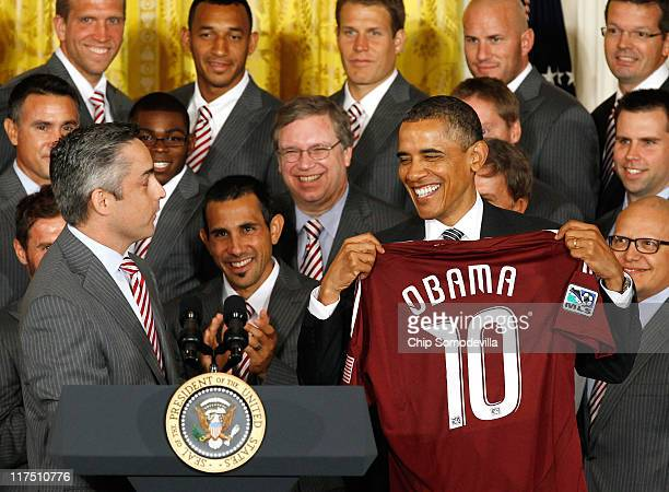 President Barack Obama holds up a jersey given to him by Colorado Rapids Managing Director Jeff Plush while welcoming members of the Major League...