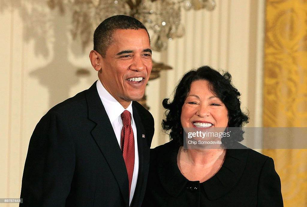 U.S. President Barack Obama (L) hosts a reception for new Supreme Court Associate Justice Sonia Sotomayor in the East Room of the White House August 12, 2009 in Washington, DC. Sotomayor, who is the first Hispanic and the third woman to be appointed to the Supreme Court, is expected to begin hearing oral arguments with the other justices in September.