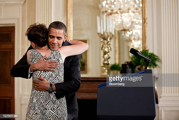 US President Barack Obama hugs Amy Wilhite of Marblehead Ohio who's daughter daughter suffers from acute myeloid leukemia during an event in the East...