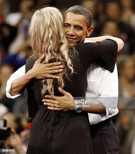 President Barack Obama hugs cancer survivor Rachel Peck during a rally at University of Maryland Comcast Center on September 17 2009 in College Park...
