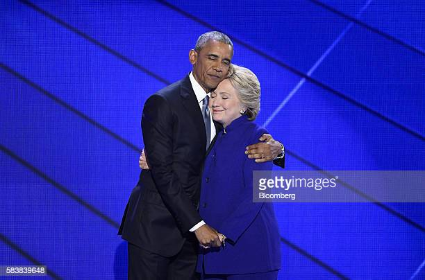US President Barack Obama hugs Hillary Clinton 2016 Democratic presidential nominee on stage during the Democratic National Convention in...