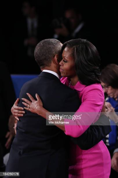 S President Barack Obama hugs Michelle Obama after a town hall style debate with Republican presidential candidate Mitt Romney at Hofstra University...
