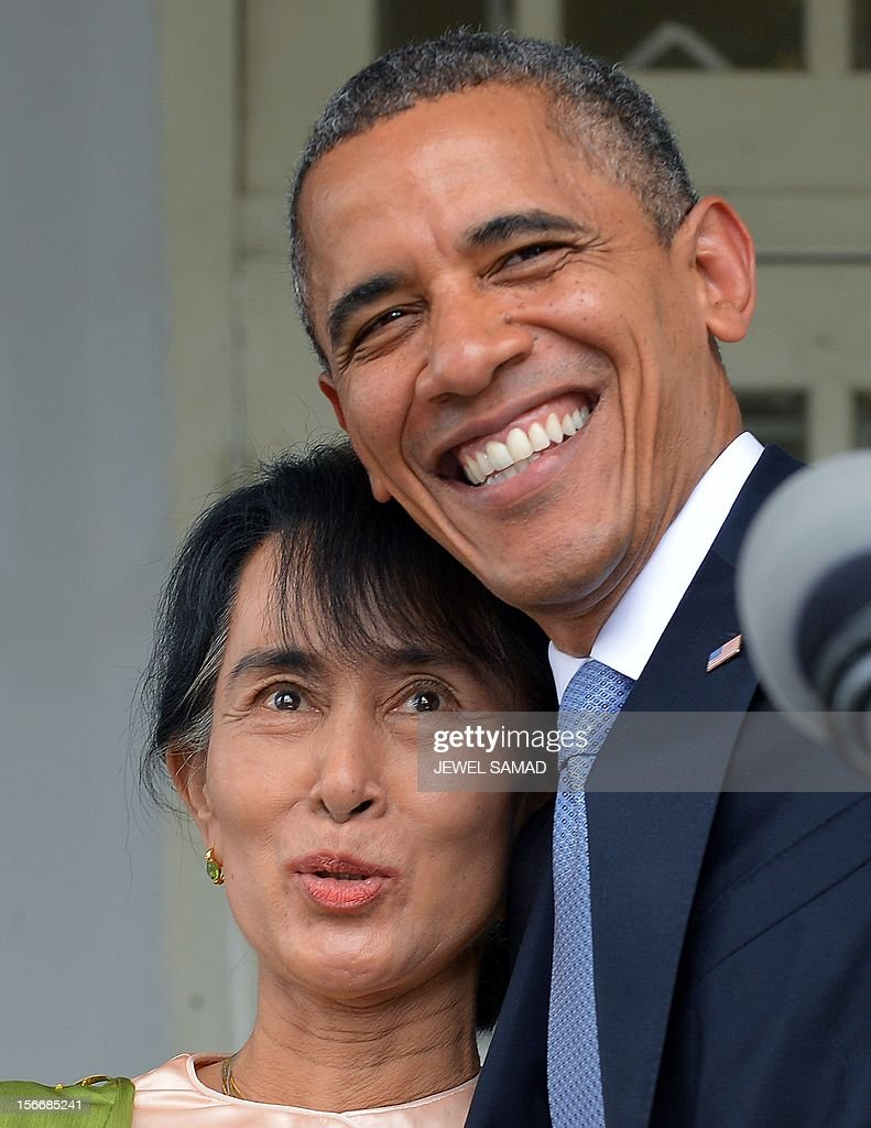 US President Barack Obama hugs Myanmar opposition leader Aung San Suu Kyi (L) as they leave after making a speech at her residence in Yangon on November 19, 2012. Obama met Myanmar democracy icon Aung San Suu Kyi during a historic visit to Yangon aimed at encouraging political reforms. AFP PHOTO / Jewel Samad