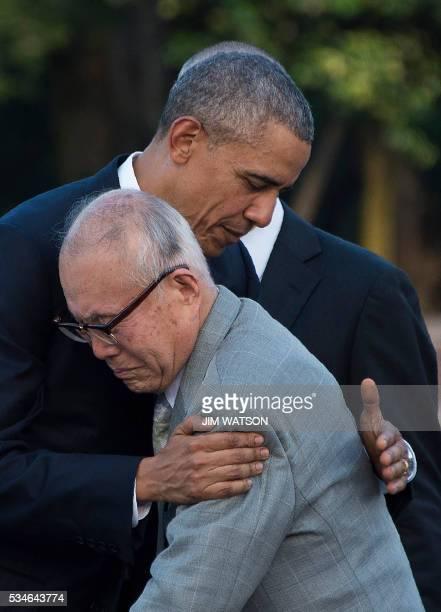 US President Barack Obama hugs Shigeaki Mori a survivor of the 1945 atomic bombing of Hiroshima during a visit to the Hiroshima Peace Memorial Park...