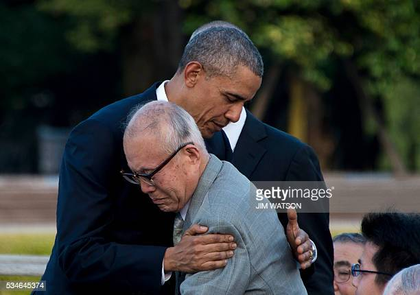 US President Barack Obama hugs Shigeaki Mori a survivor of the 1945 atomic bombing of Hiroshima during a visit to the Hiroshima Peace Memorial Park...