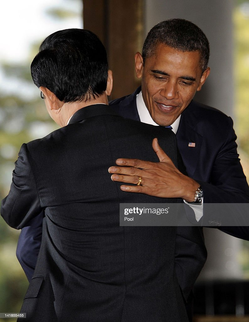 U.S. President Barack Obama (L) hugs South Korean President Lee Myung-Bak before their meeting at the presidential house on March 25, 2012 in Seoul, South Korea. World leaders are gathering in Seoul to discuss the threat of nuclear terrorism, the recurrence nuclear power plant meltdown and to minimize nuclear material across the world.