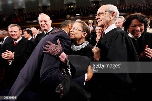 S President Barack Obama hugs Supreme Court Justice Ruth Bader Ginsburg as Supreme Court Justices John Roberts Anthony Kennedy Stephen Breyer and...
