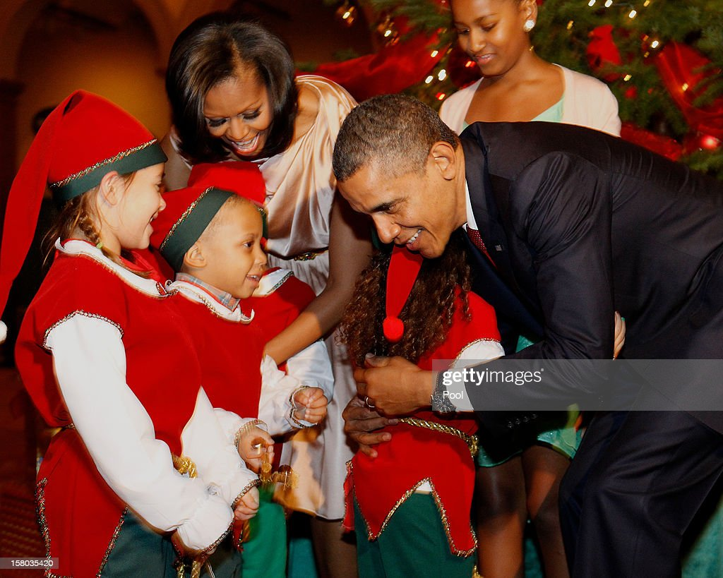 U.S. President Barack Obama hugs the Christmas elves as they attend the 'Christmas in Washington' concert at the National Building Museum on December 9, 2012 in Washington, D.C. The concert benefits the National Childrens Medical Center and is hosted by comedian Conan O'Brien.