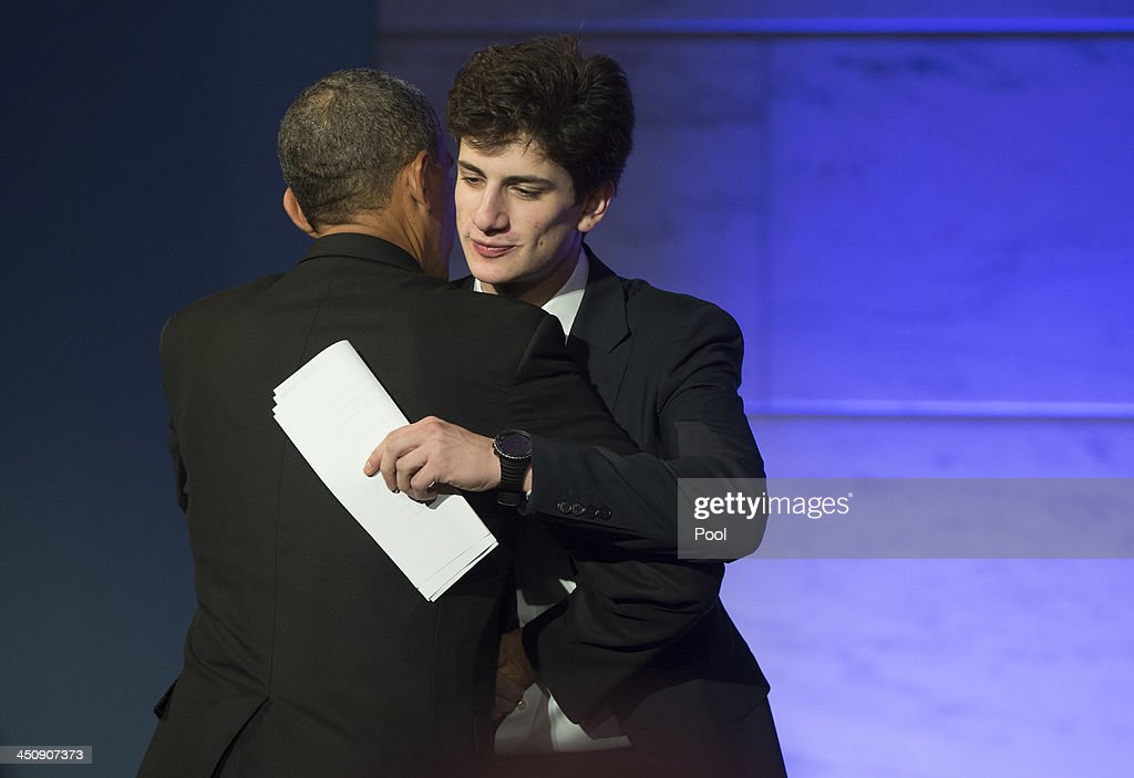 President Barack Obama hugs the Jack Schlossberg, the Grandson of President John F. Kennedy, after he introduced Obama, during a dinner in honor of the Medal of Freedom awardees at the Smithsonian National Museum of American History on November 20, 2013 in Washington, DC. The Presidential Medal of Freedom is the nation's highest civilian honor, presented to individuals who have made meritorious contributions to the security or national interests of the United States, to world peace, or to cultural or other significant public or private endeavors.