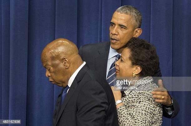 US President Barack Obama hugs US Attorney General Loretta Lynch as US Congressman John Lewis DGeorgia departs after speaking marking the 50th...