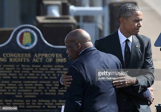 President Barack Obama hugs U.S. Rep John Lewis during a commemoration of the 50th anniversary of the historic civil rights march on March 7, 2015 in...