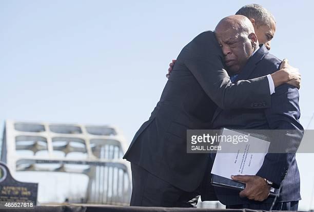 President Barack Obama hugs US Representative John Lewis, Democrat of Georgia, one of the original marchers at Selma, during an event marking the...
