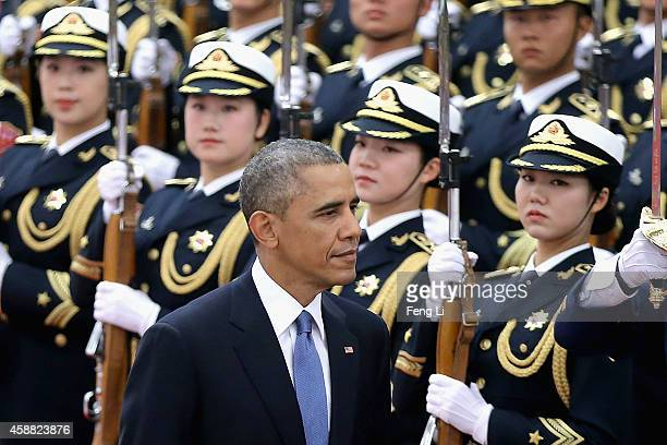 S President Barack Obama inspects a guard of honor along with Chinese President Xi Jinping during a welcoming ceremony inside the Great Hall of the...