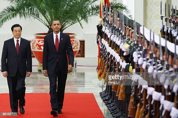 President Barack Obama inspects a guard of honor along with Chinese President Hu Jintao at the Great Hall of the People on November 17, 2009 in...