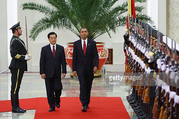 S President Barack Obama inspects a guard of honor along with Chinese President Hu Jintao at the Great Hall of the People on November 17 2009 in...