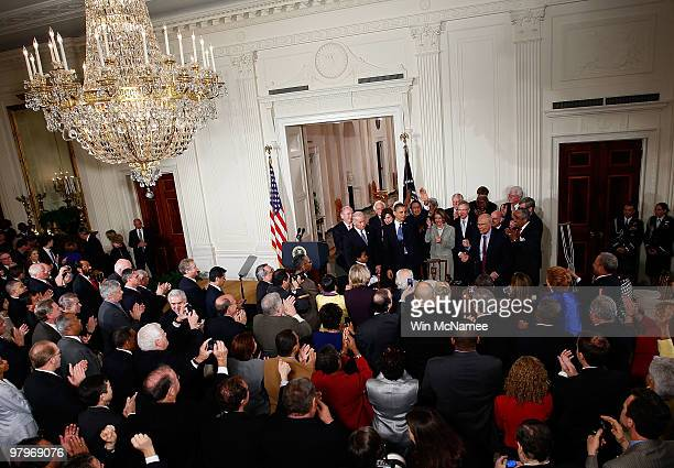 S President Barack Obama is applauded after signing the Affordable Health Care for America Act during a ceremony with fellow Democrats in the East...