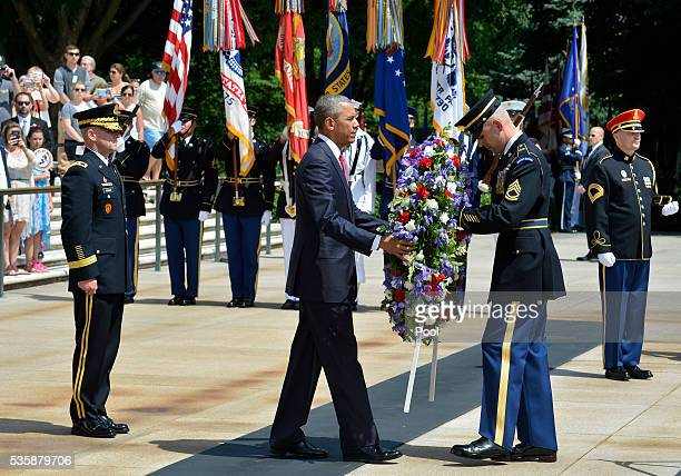 President Barack Obama is assisted as he lays a wreath at the Tomb of the Unknown Soldier at Arlington National Cemetery on May 30 2016 in Arlington...