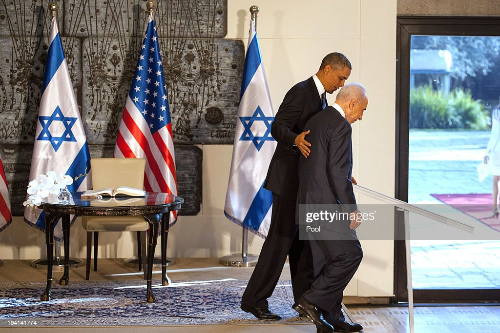 U.S. President Barack Obama (L) is escorted by Israeli President Shimon Peres following a welcome ceremony at the President's residence on March 20, 2013 in Jerusalem, Israel. This will be Obama's first visit as president to the region, and his itinerary will include meetings with the Palestinian and Israeli leaders as well as a visit to the Church of the Nativity in Bethlehem.