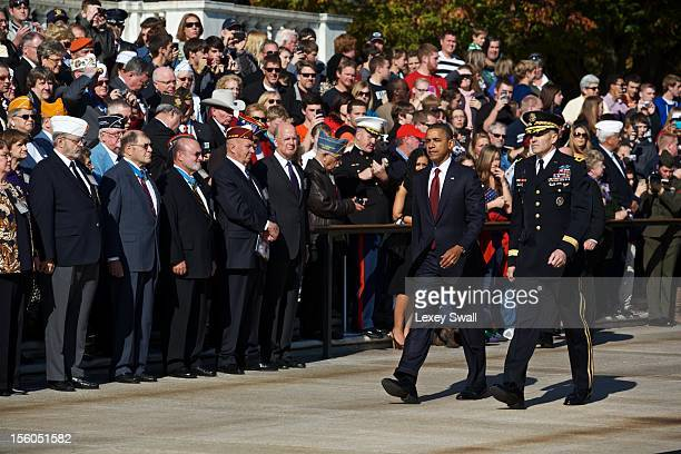 S President Barack Obama is escorted to the Tomb of the Unknowns by Major General Michael S Linnington during the Presidential WreathLaying Ceremony...