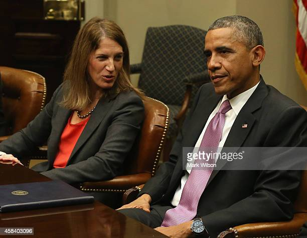 President Barack Obama is flanked by HHS Secretary Sylvia Mathews Burwell during a meeting with his national security and public health teams in the...