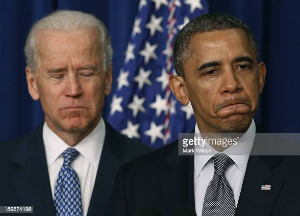 S President Barack Obama is flanked by Vice President Joe Biden before signing an executive order designed to tackle gun control on January 16 2012...