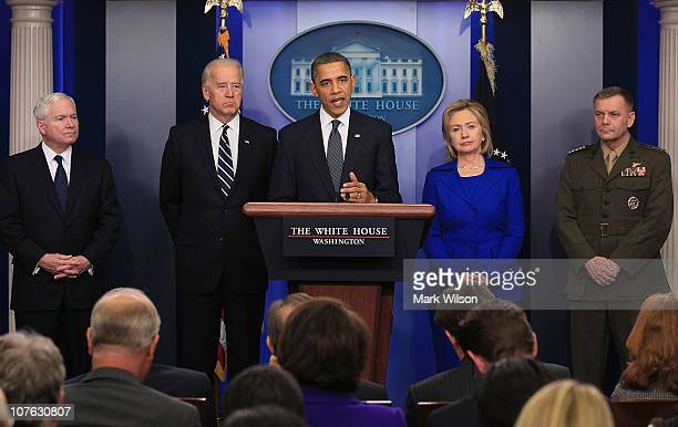 S President Barack Obama is flanked by Vice President Joseph Biden Secretary of Defense Robert Gates Secretary of State Hillary Clinton and Vice...