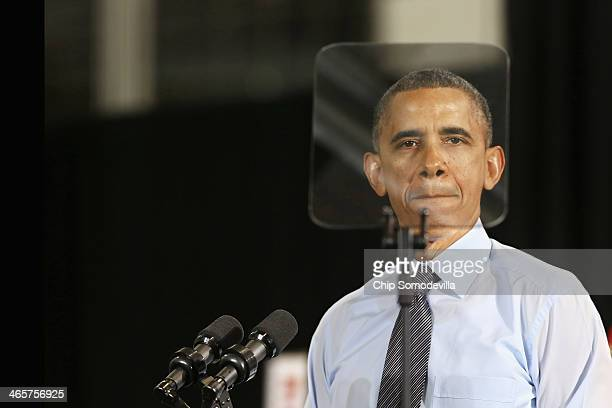 President Barack Obama is framed by his teleprompter while delivering remarks at the Costco wholesale store, repeating some of the same policy...