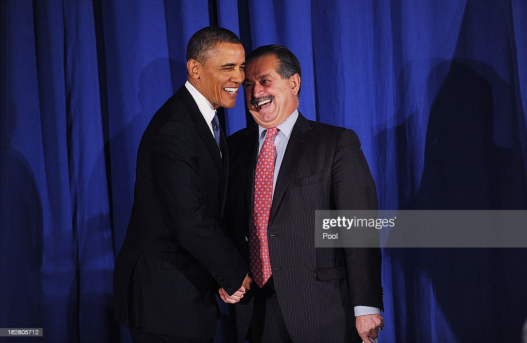 U.S. President Barack Obama is greeted by Andrew Liveris, President, Chairman and Chief Executive Officer of The Dow Chemical Company at the Business Council dinner February 27, 2013 at the Park Hyatt Hotel in Washington, DC. The Business Council is comprised of business leaders in the United States.