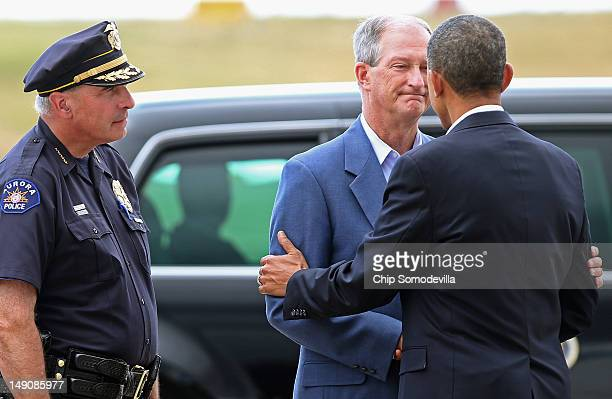 US President Barack Obama is greeted by Aurora Police Chief Dan Oates and Aurora Mayor Steve Hogan after arriving at Buckley Air Force Base July 22...