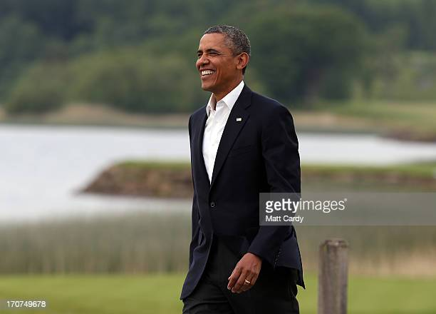 President Barack Obama is greeted by Britain's Prime Minister David Cameron at the official arrival of the G8 leaders at the G8 venue of Lough Erne...