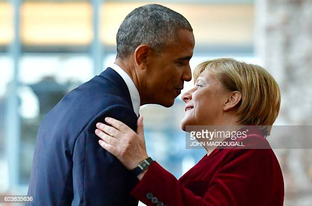 US President Barack Obama is greeted by German Chancellor Angela Merkel at the chancellery on November 17 2016 in Berlin US President Barack Obama...