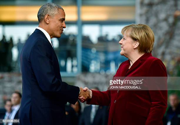 US President Barack Obama is greeted by German Chancellor Angela Merkel upon arrival at the chancellery on November 17 2016 in Berlin US President...
