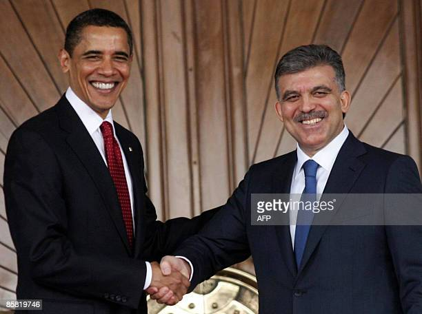 President Barack Obama is greeted by his Turkish counterpart Abdullah Gul during a welcoming ceremony at Cankaya Palace in Ankara on April 6, 2009....