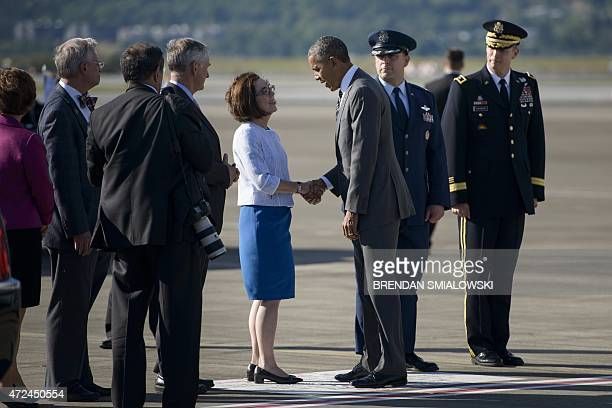 US President Barack Obama is greeted by Oregon Governor Kate Brown at the Oregon Air National Guard Base May 7 2015 in Portland Oregon AFP...