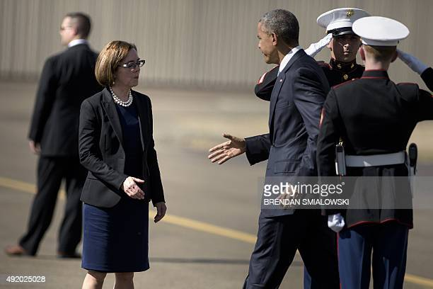 US President Barack Obama is greeted by Oregon Governor Kate Brown on October 9 2015 in Roseburg Oregon Obama meets survivors of last week's massacre...