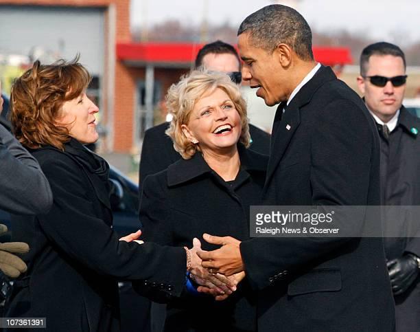 President Barack Obama is greeted by Sen Kay Hagan left and North Carolina Gov Bev Perdue in Greensboro North Carolina on Monday December 6 2010