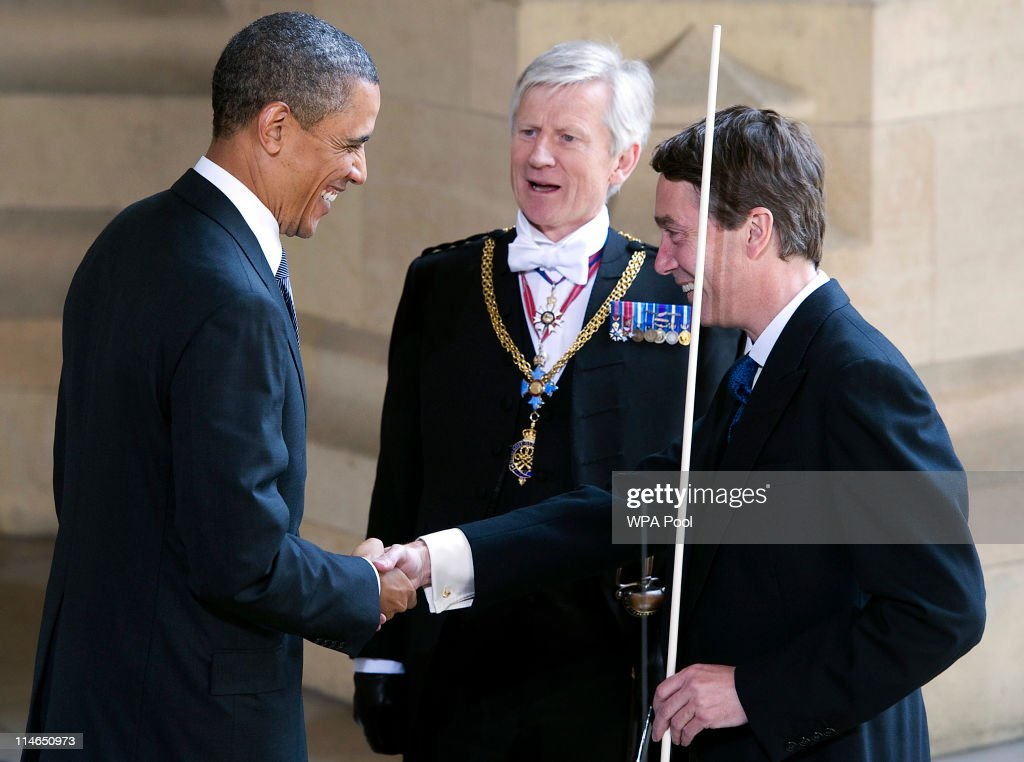 U.S President Barack Obama (C) is greeted by the Lord Great Chamberlain, the Marquess of Cholmondeley (R), and Lieutenant General David Leakey, known as 'Black Rod' (C) as he arrives at the Sovereigns Entrance to the Palace of Westminster on May 25, 2011 in London, England. The 44th President of the United States, Barack Obama, and his wife Michelle are in the UK for a two day State Visit at the invitation of HM Queen Elizabeth II. Last night they attended a state banquet at Buckingham Palace and today's events include talks at Downing Street and the President will address both houses of parliament at Westminster Hall.
