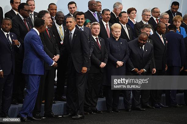 President Barack Obama is greeted by world leaders as he arrives for the family photo at the COP21, United Nations Climate Change Conference, in Le...